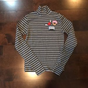 Patched ribbed turtleneck